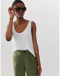 Camiseta sin mangas lisa en blanco Pieces de color White