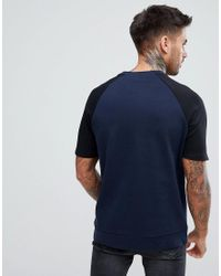 ASOS Blue Asos Sweatshirt With Short Sleeve And Contrast Arms In Navy And Black for men