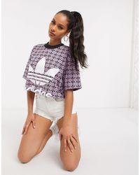 T-shirt corta con trifoglio lampone Magic e nera di Adidas Originals in Multicolor