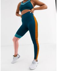 Leggings colourblock cropped di Nike in Blue