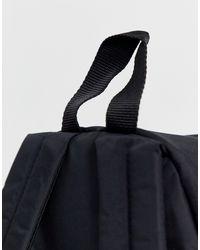 Mochila negra Orbit Sleek'r Eastpak de color Black