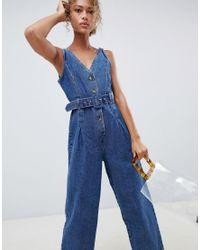 Tuta jumpsuit di jeans blu medio slavato con bottoni di ASOS in Blue