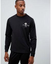 Felpa tricot in poliestere con stampa sul davanti di ASOS in Black da Uomo