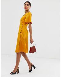 Unique 21 - Vestito a portafoglio a maniche corte con bottoni di UNIQUE21 in Yellow