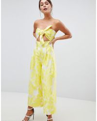 1336bccf47 ASOS Bandeau Jacquard Jumpsuit With Knot Detail in Yellow - Lyst
