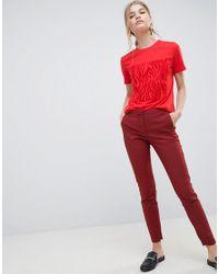 Muse SELECTED en coloris Red