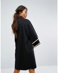 Monki Black Ruffle Sleeve Zip Up Sporty Dress
