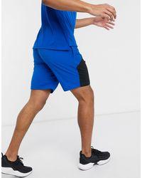 Reebok Blue Training Woven Shorts for men