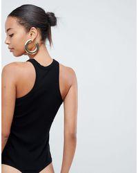 ASOS DESIGN Tall - Body côtelé à découpes et encolure haute ASOS en coloris Black