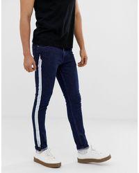 Jeans super skinny indaco con riga bianca di ASOS in Blue da Uomo