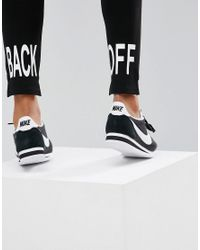 ASOS - Black Skinny Ponte Trousers With Stepped Hem And Back Off Print - Lyst