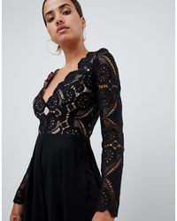 Combinaison à découpes avec top en dentelle et bas large fendu Love Triangle en coloris Black