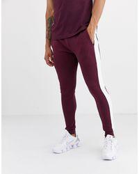 Joggers ajustados con rayas laterales en burdeos ASOS de hombre de color Purple