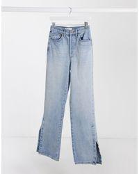 Jeans dad fit con spacchi sul fondo lavaggio candeggiato di TOPSHOP in Blue