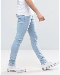 New Look Muscle Fit Jeans In Light Wash Blue for men
