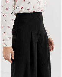 Gonna pantalone a pieghe nera di Warehouse in Black