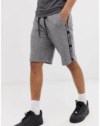 Pantaloncini nella tuta grigio mélange con fettuccia laterale e logo stampato di Hollister in Gray da Uomo
