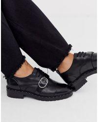 Zapatos planos de cuero en negro Bronx de color Black