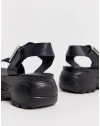 Truffle Collection Black – Flache, sportliche Chunky-Sandalen