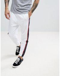 Le De Pantalon Jogging Côté Sur Lyst Armani En Nylon Rayures Avec 8Twndx5q
