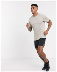 Miler - T-shirt con logo beige di Nike in Natural da Uomo