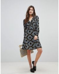 Liquorish - Black Long Sleeved Wrap Dress With Frilled Neckline In Mozaic Print - Lyst