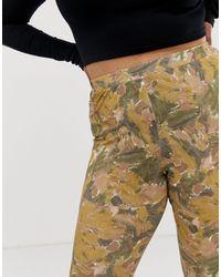 ASOS DESIGN Curve - Legging à imprimé abstrait ASOS en coloris Multicolor