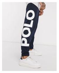 Joggers extragrandes en azul marino con bajos ajustados, estampado grande y logo Polo Ralph Lauren de hombre de color Blue