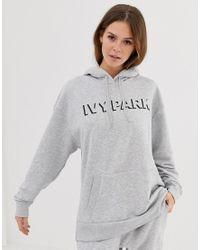 Hoodie à logo Ivy Park en coloris Gray