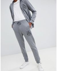 Love Moschino Graue, enge Jogginghose mit Logo in Gray für Herren