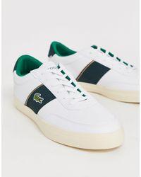 Lacoste – Courtmaster – Sneaker aus weißem Leder mit grünen Streifen an der Seite in White für Herren
