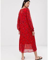 Robe longue plissée à fleurs SELECTED en coloris Red