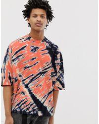 T-shirt oversize a mezze maniche lavaggio tie-dye a contrasto di ASOS in Multicolor da Uomo