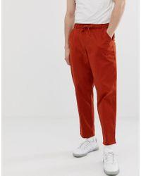 Chino comodi ruggine con elastico di ASOS in Red da Uomo