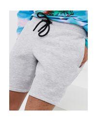 Short style jogger Collusion pour homme en coloris Gray