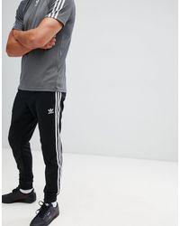 Superstar - Jogger à trois bandes adidas Originals pour homme en ...