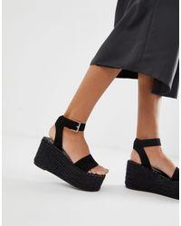 Simmi - London - Melanie - Sandales compensées plates façon espadrilles SIMMI Shoes en coloris Black