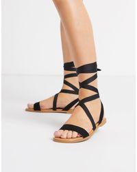 Sandales plates avec liens à nouer ASOS en coloris Black