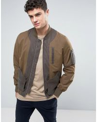 ASOS Green Bomber Jacket With Exposed Pockets In Khaki for men