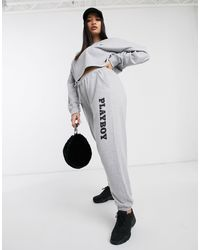 "Joggers grigi con scritta ""Playboy"" di Missguided in Gray"