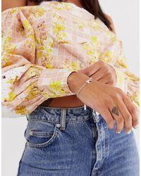 Bracelet chaîne papillon en argent massif Olivia Burton en coloris Metallic