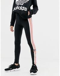 Leggings neri con tre strisce e logo vintage di Adidas Originals in Black