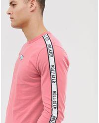 Top manches longues avec bande logo aux manches et sur le devant - sombre Hollister pour homme en coloris Pink