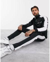 Joggers slim negros con ribetes reflectantes ASOS de hombre de color Black