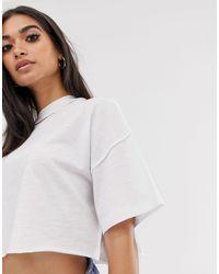 Camiseta corta recta con costuras expuestas en blanco ASOS de color White