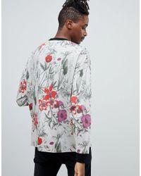 T-shirt oversize à manches longues et imprimé floral sur l'ensemble ASOS pour homme en coloris Gray