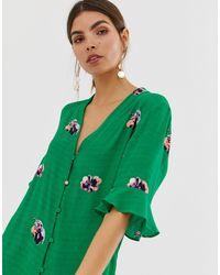 Top a maniche corte a fiori di Y.A.S in Green