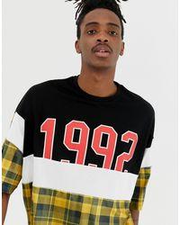 Camiseta extragrande con paneles remendados ASOS de hombre de color Black