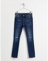 River Island – Sehr eng geschnittene Jeans mit Zierrissen und Flicken in Blue für Herren