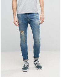 ASOS Super Skinny Jeans With Abrasions In Mid Blue for men